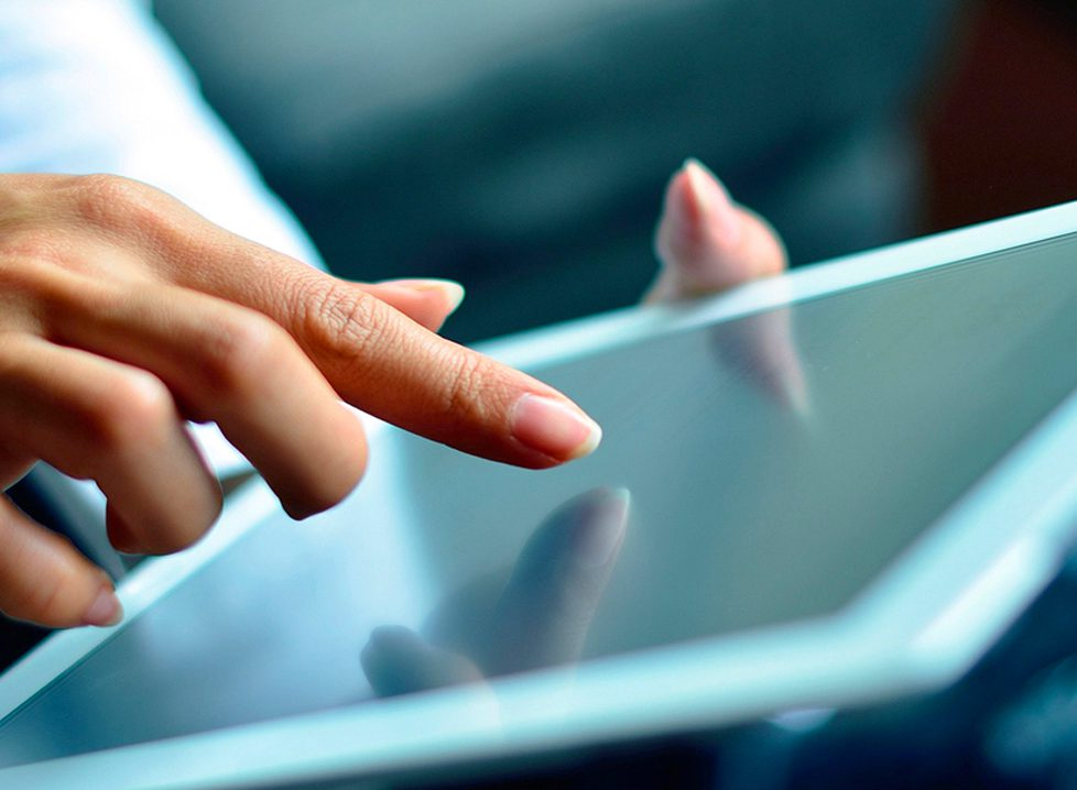 Woman on an ipad - Law Office of Boyd & Wills, a Limited Liability Company LLC with Business Formation Lawyers, Real Estate Attorneys, and Contract Attorneys in Franklin, TN